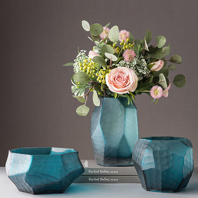 Decorate your home with fresh flowers or green botanicals with our selection of glass, ceramic and porcelain vases.  These vases are handmade products, each piece is one of a kind and is completely unique.