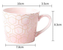 Load image into Gallery viewer, Looking for a suitable drinkware that matches your style? Enjoy your drink in style with this gold geometric marble mug.