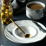 This coffee or tea cup sits nicely in the deep bowl-shaped saucer so you don't have to worry about cup falling off. Gold trim adds a subtle touch of elegance and handle is easy to grip and hold with the thick wall to keep your beverage warm.