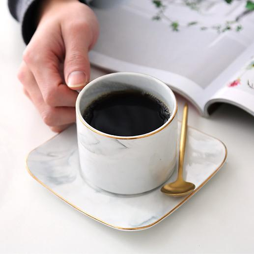 Looking for your ideal marble coffee and teacup set for your daily cuppa? The perfect marble cup set that you'll love to use every day. Cup and square rounded edges saucer is lined with gold trim and comes with a gold spoon that reflects a chic and elegant style.