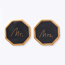 Load image into Gallery viewer, Protect your table and looks chic with these gorgeous black and white couple ceramic coasters. Not just to sit your beverage, Mr and Mrs coasters has a gold trim edge to add a chic look.