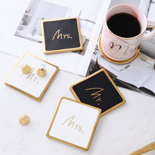 Görseli Galeri görüntüleyiciye yükleyin, Protect your table and looks chic with these gorgeous black and white couple ceramic coasters. Not just to sit your beverage, Mr and Mrs coasters has a gold trim edge to add a chic look.