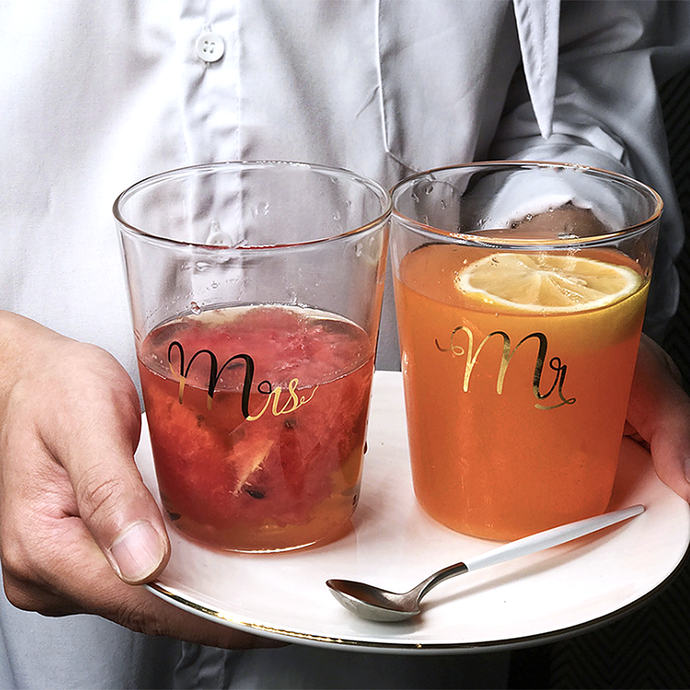 Fall in love with these Couple Glass Cup Set. Gold foiled monogram with Mr and Mrs makes a chic yet heartwarming wedding gift or use with your loved one. The 400ml cup size is suitable for your smoothies, salads, fruits or oatmeals. Also great for juice, milk, ice tea, lemonade, soda or your favorite fruits infused water.