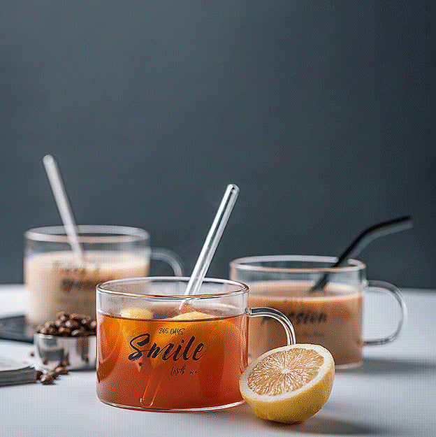 Glass mug for your hot or cold drinks. Made with quality borosilicate glass for durability and heat resistance. Microwave and dishwasher safe.      This transparent drinking glass mug is perfect for holding juices, shakes, soda, iced coffee or tea, fruit-infused drink and many others.  Glass straw is optional.