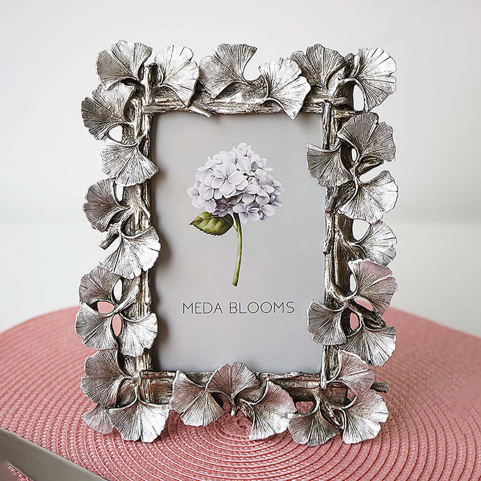 The stylish silver finishes with a distressed look and complements any style decor adding a chic addition to your entryway table or bookshelf. This silver frame has an easel stand for tabletop display.