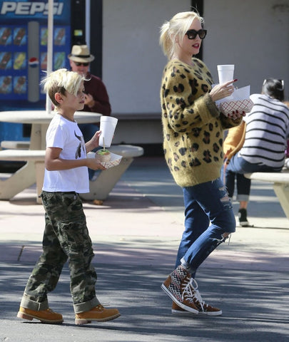 Gwen Stefani showing look for animal print sneakers like Cape Robbin Superstar