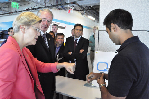 Senators Warren and Markey checking out QMedic