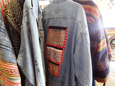 Denim jackets with inset swaths of colorful fabrics handmade by mountain tribes in southeast Asia are popular at the Elephant Story.