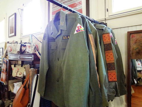 The Elephant Story sells army fatigue jackets enhanced with colorful, hand woven Asian fabrics.