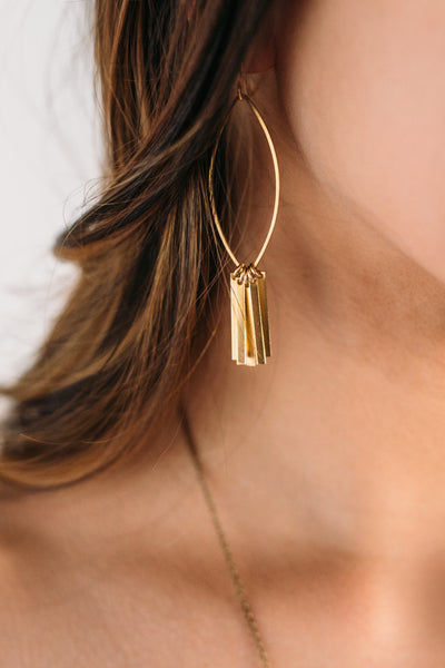 Page -- brass dangle and ellipse earrings