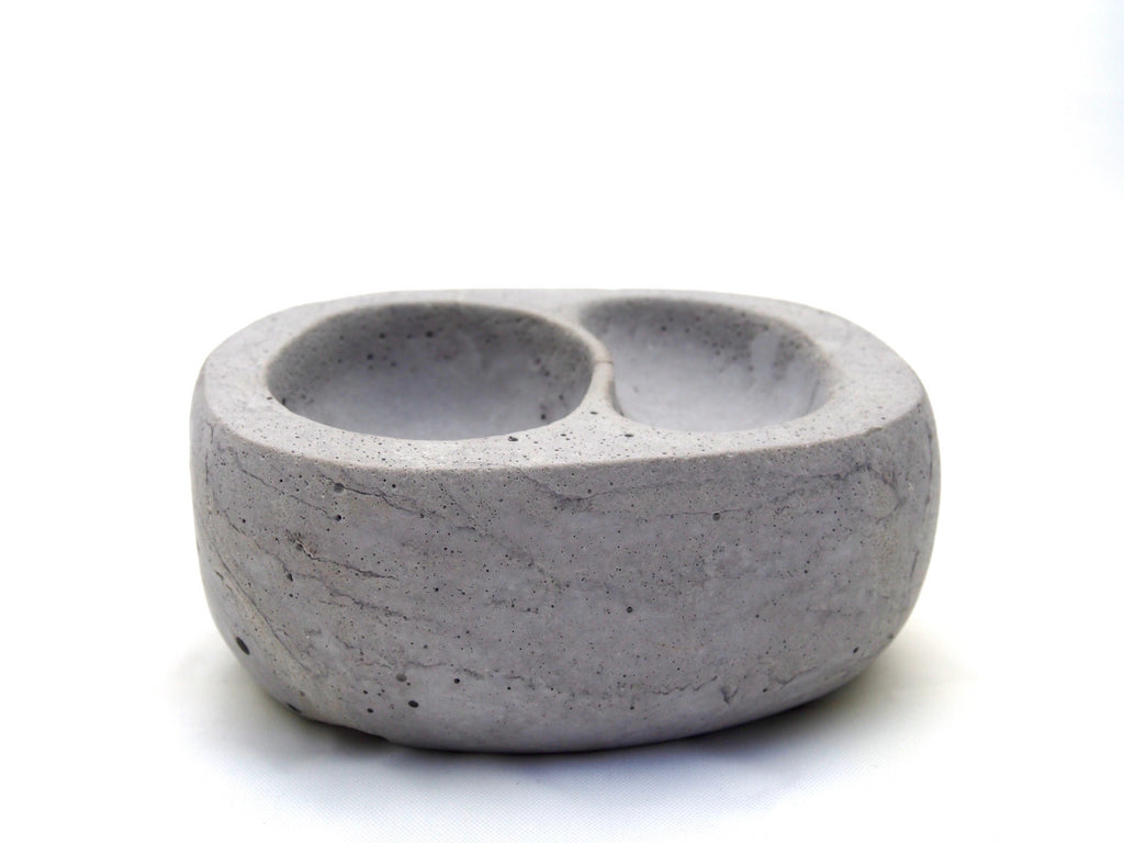 The Stephanie bowl, small grey concrete, two nestled indentations, side view