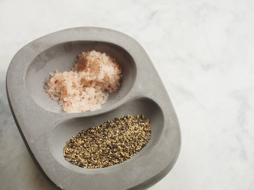 Stephanie concrete small bowl with salt & pepper top view