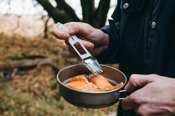 spork being used on the muncher titanium multi camping utensil