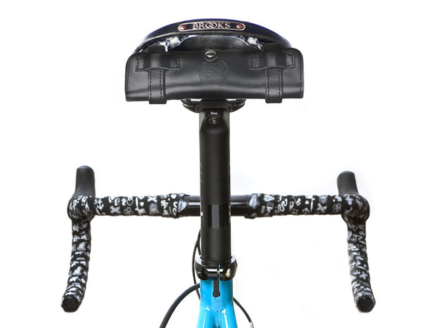 the nutter cycle multi tool strapped underneath a brooks saddle