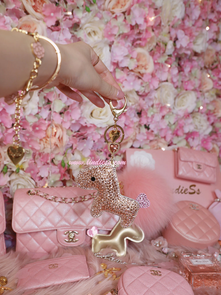PRINCESS SWAROVSKI HORSE POM POM - ROSE GOLD