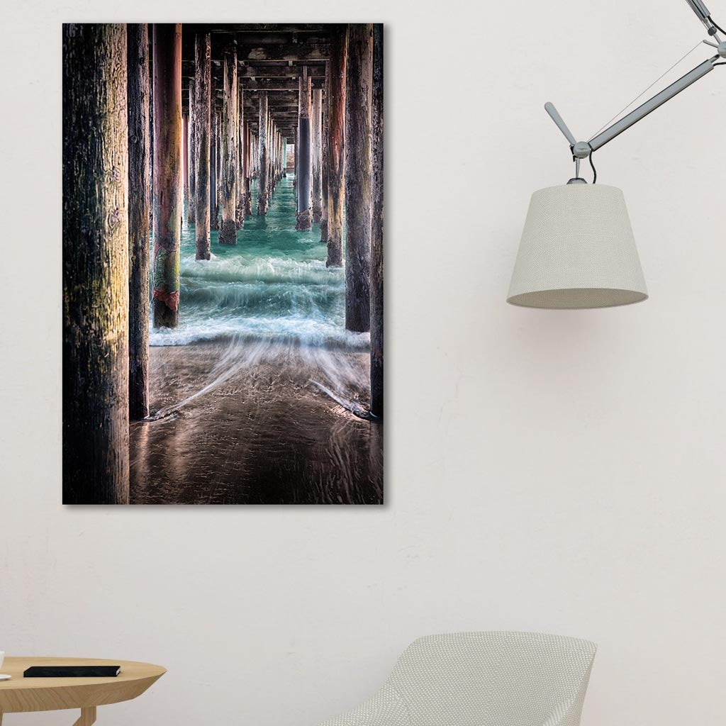 Under the Pier metal print hanging in studio living room