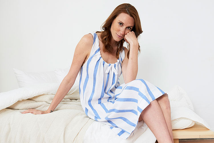 Woman in bold white and blue stripe cotton nightgown