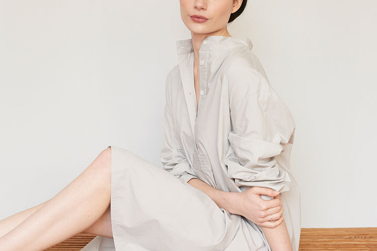 Woman in chic cotton luxury pajamas in light grey