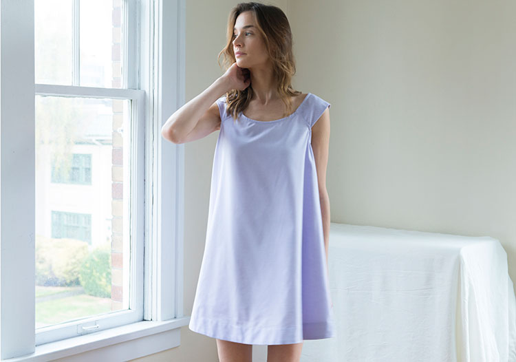 Model standing by window in Swing Nightie in Lilac Royal Oxford
