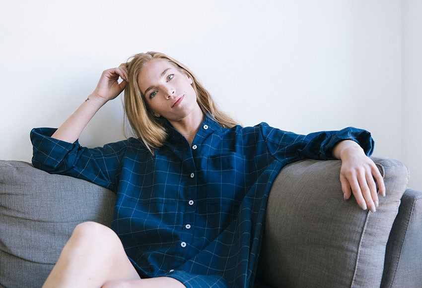 Model sitting in the Placket Sleep Shirt Navy Windowpane Flannel