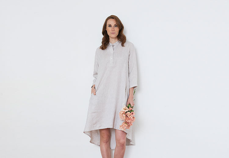 woman in sand colored linen day dress