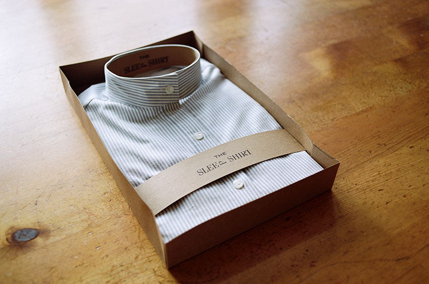 Classic short sleep shirt in blue oxford stripe folded in gift box.