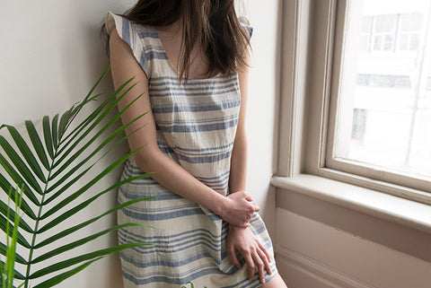 Model wearing Scoop Neck Nightie in Beach Stripe near a window and greenery