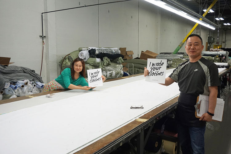 Factory worker holding sign from Fashion Revolution, I made your clothes campaign