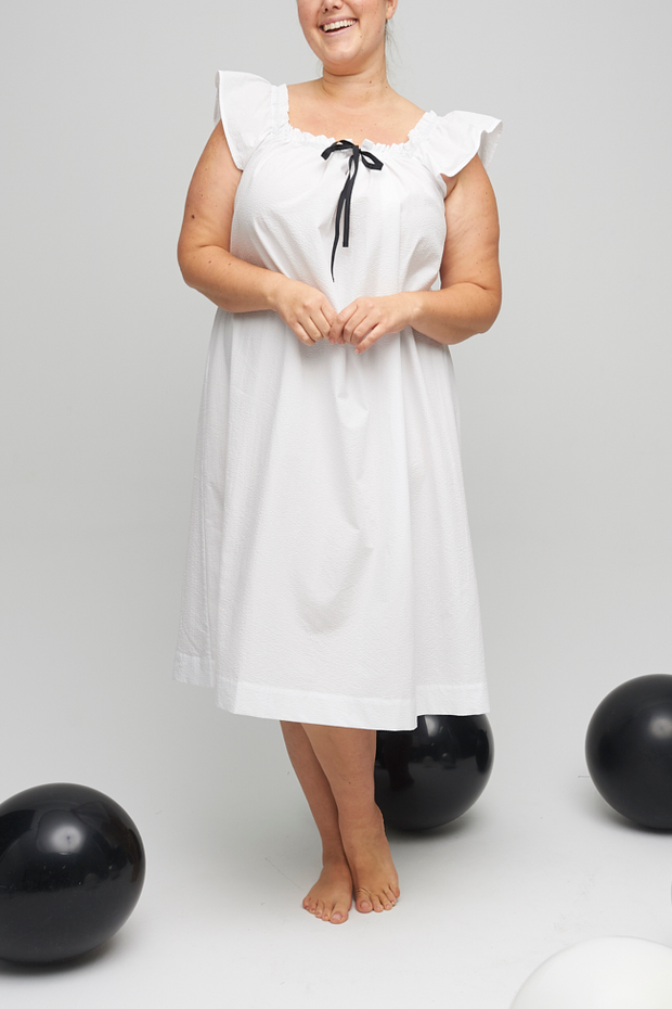 Both a nightie and a cocktail dress, The Party Nightie falls below the knee with a flared silhouette. A gathered neckline make the fit just right.