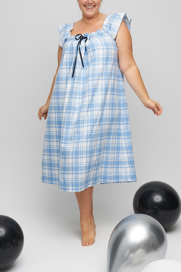 The Party nightie is a gorgeous, comfortable nightdress that can be worn as a cocktail dress. Gathered neckline with a grosgrain ribbon, made from a cream and blue flannel cotton.