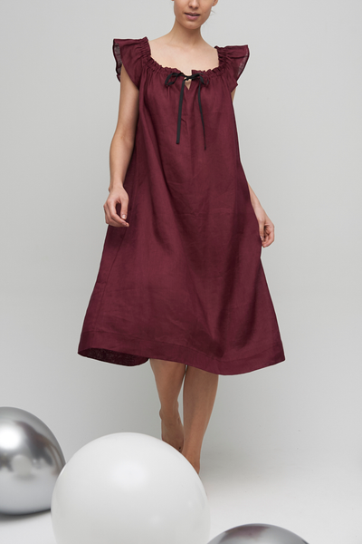 The Party Nightie bridges your event calendar and your sleep schedule. Falling below the knee with a flared silhouette; made in a luxe deep burgundy linen. Gathered neckline makes the fit just right.