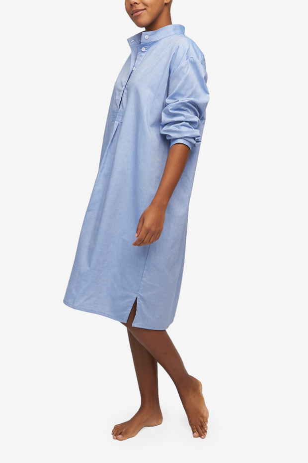 Long Sleep Shirt made from a blue oxford cotton, a robust yet comfortable fabric. Falls below the knee with long, cuffed sleeves.