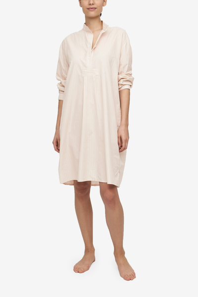A Short Sleep Shirt in a cream cotton and silk blend, it has subtle cream and brown vertical stripes. It hits just below the knee on average height people but will offer modest coverage for most wearers.