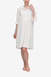 A traditional nightshirt in a classic white royal oxford shirting. The placket has the top two buttons open to show that the collar can be worn folded down.