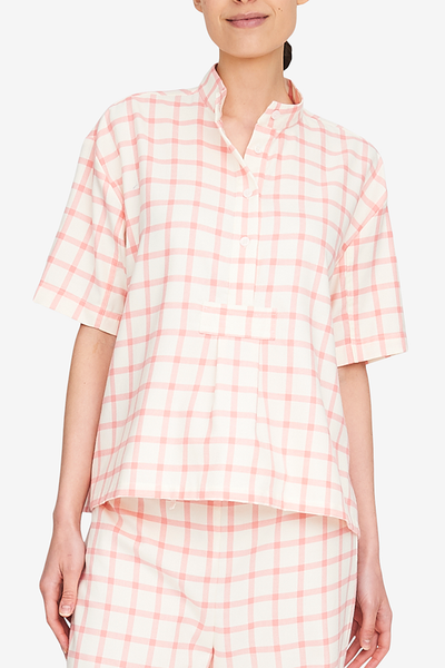 Front view of the Short Sleeve Cropped Shirt, a hip-length version of our classic shirts. This cream and pink flannel is cute and will only get better with washing and wearing. Looks great with the matching pants on on its own with jeans.
