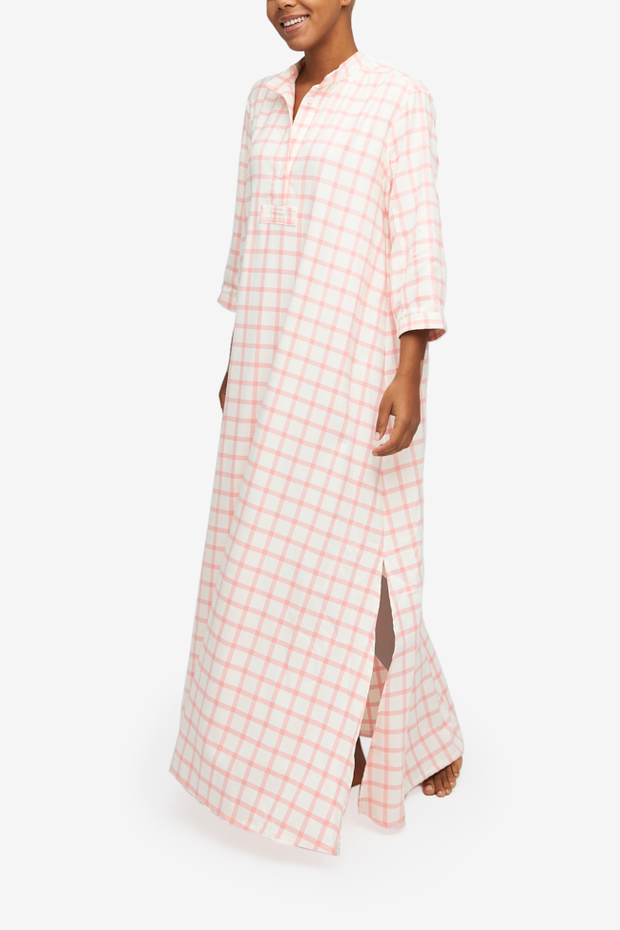 The Full Length Sleep Shirt in a cream and pink check flannel. Floor length, with side slits for ease of movement.