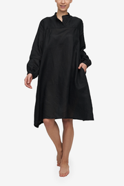 Knee-length black linen Sleep Shirt, with a billowy bishop sleeve and a flared silhouette. And pockets!
