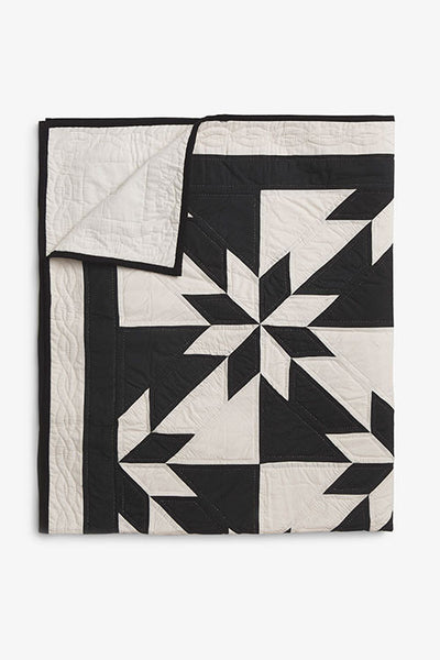 folded throw size black and cream pattern amish cotton blanket quilt handmade in USA by the Sleep Shirt