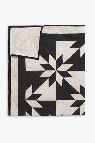 folded black and cream pattern amish wholecloth cotton blanket quilt handmade in USA by the Sleep Shirt