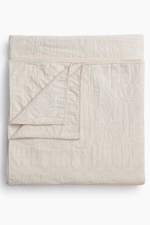 folded throw size cream amish wholecloth cotton blanket quilt handmade in USA by the Sleep Shirt