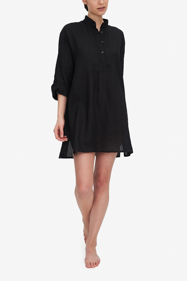 Front view of the short version of our classic long nightshirt. Shown here in Black linen, the model is swinging her arms as she walks towards the camera. The black linen shirt hits her about mid-thigh but she's our supermodel so it'll be a bit longer than that on most.