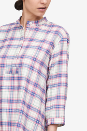 Detail of a long sleeve nightshirt with a pink, blue and green flannel check