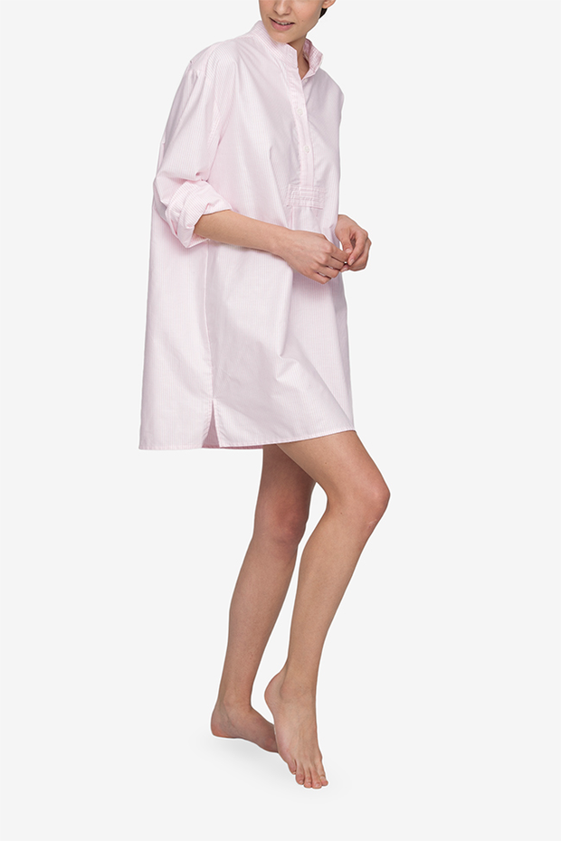 front view of the short version of our classic nightshirt. Shown here in Pink Oxford Stripe, the sleeve are loosely rolled to the elbow and the placket has a couple buttons unbuttoned for an effortless look.