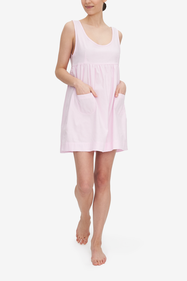 The Pocket nightie, shown here in Pink Royal Oxford cotton shirting, has a high empire waist, a tank-style bodice and a gathered skirt with two patch pocket on the front. It's on the shorter side, hitting most about mid-thigh.