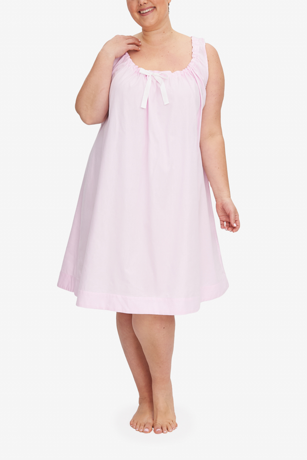 Front view of the knee-length Sleeveless Nightie Plus with a gathered neclkline. The light pink royal oxford cotton is lightweight and hangs beautifully.