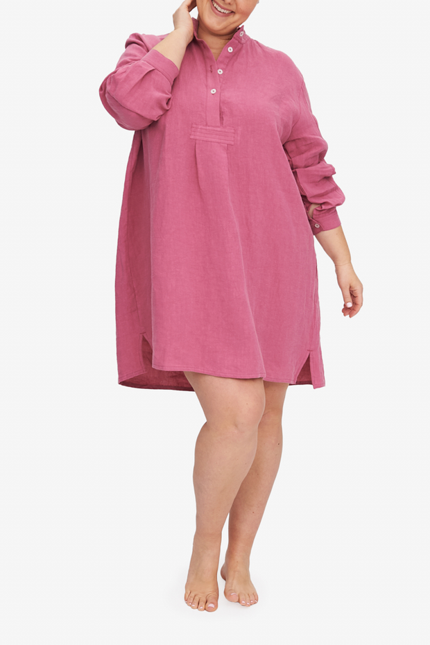 Charlotte wears the Short Sleep Shirt in Plus. This version is made in a bouncy, soft linen in a deep rose pink colour.