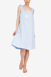 Front view of the Sleeveless Nightie, it's knee length and has a unique gathered necking with the bow tied at centre front. Shown here in a light blue linen cotton blend fabric.
