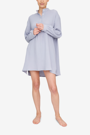 Front view of a Short Sleep Shirt in a grey-blue cotton double gauze. If you haven't felt a double gauze before, it's incredibly lightweight but still thick and cozy. It's like duvet you wear and never want to take off.