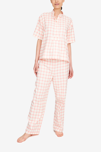 Traditional pj set of a short sleeve, over the head shirt and matching pyjama pants. This cream and pink flannel is fun and sophisticated at the same time.