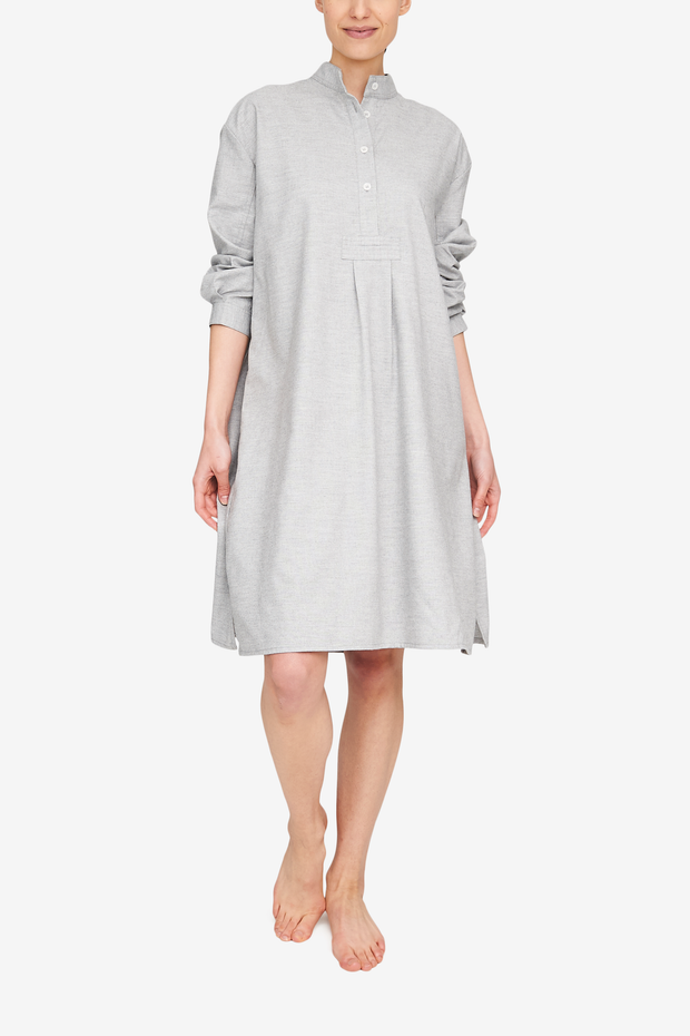 Woman wearing a knee length sleep shirt in a gorgeous blend of cotton and cashmere in a light grey. So luxurious!